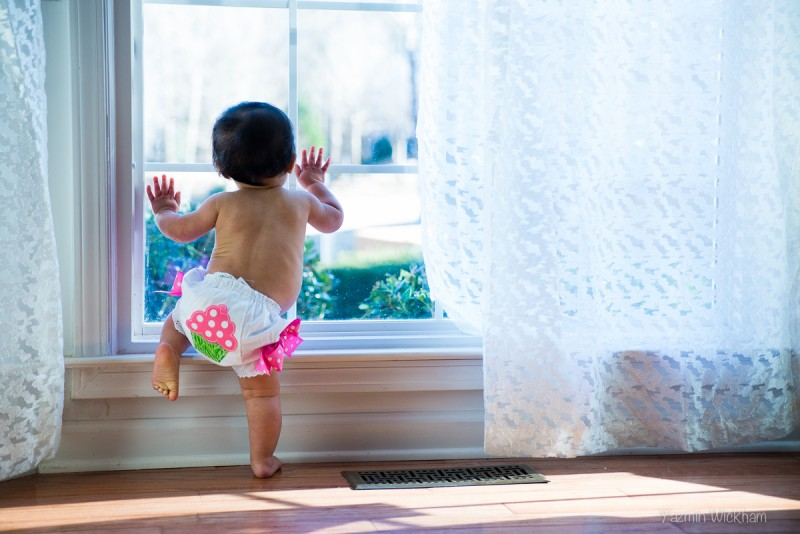 Baby crawling on window ledge