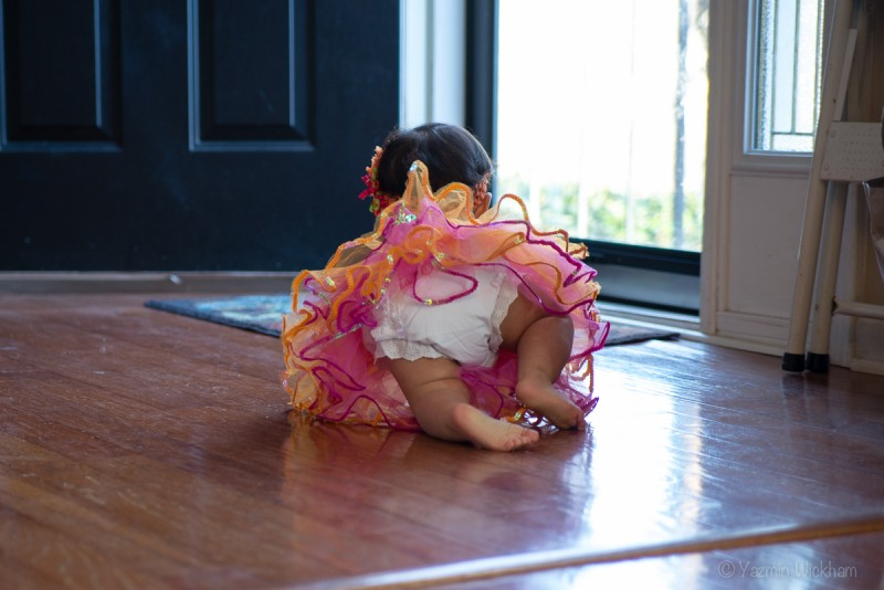 Baby bottom crawling in tutu