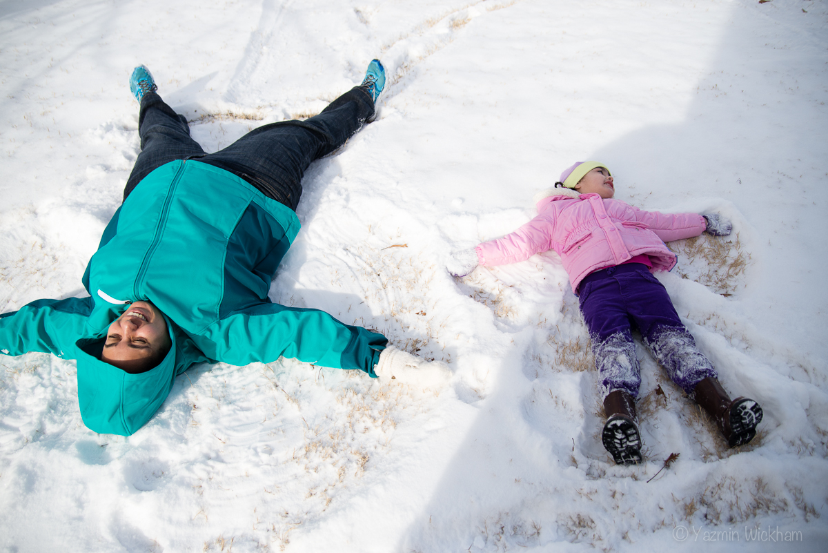 Making snow angels with the girl