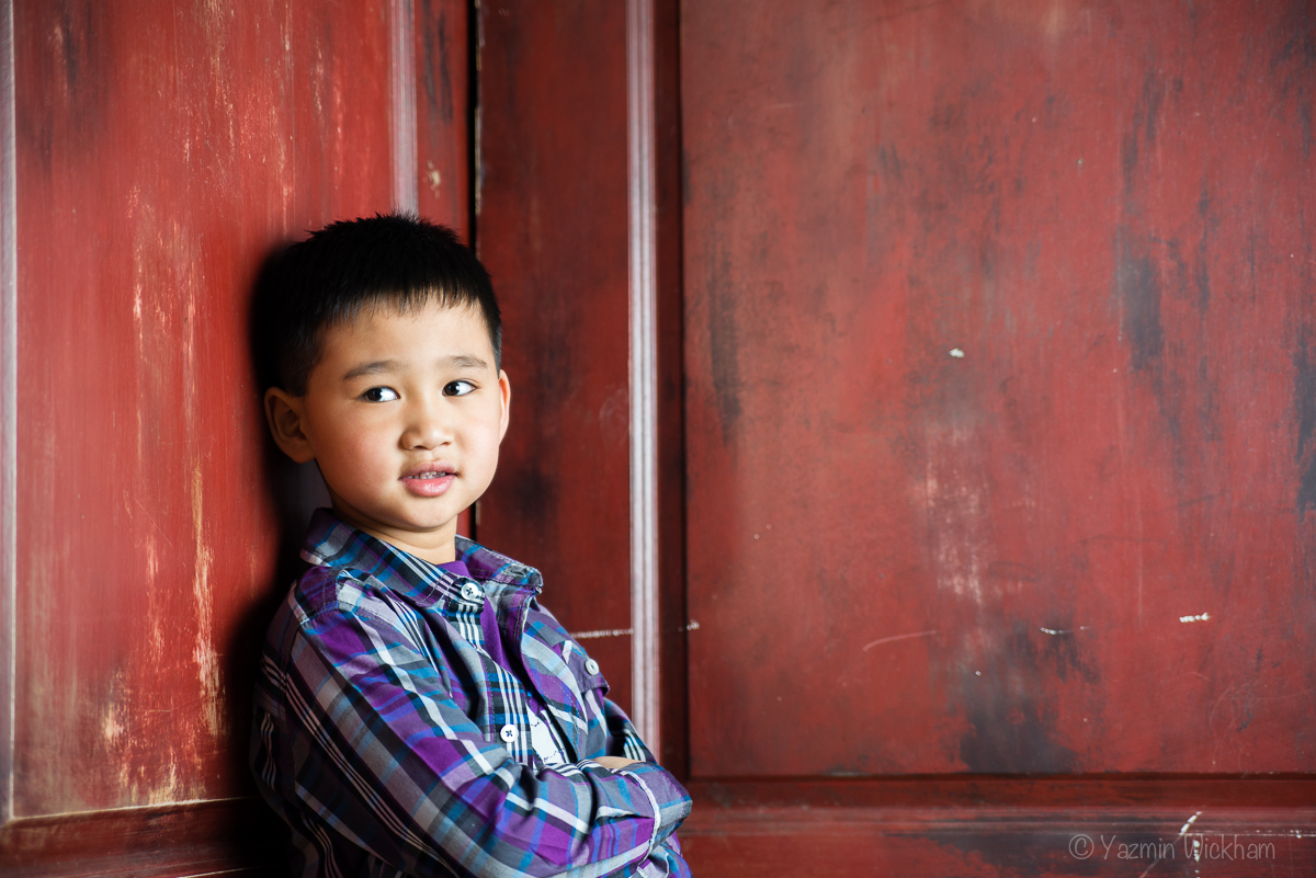 Boy leaning on door - flash photography shot