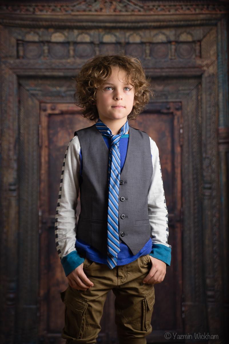 Boy standing in front of doorway - flash photography shot