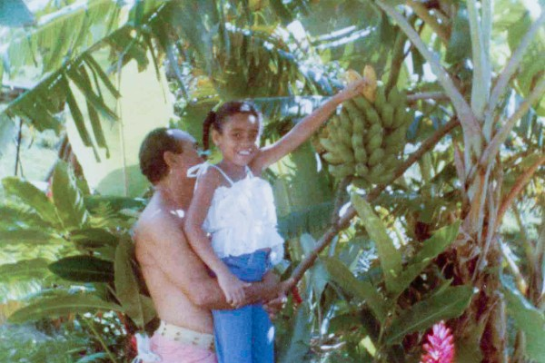 Picking bananas with Abuelito's help